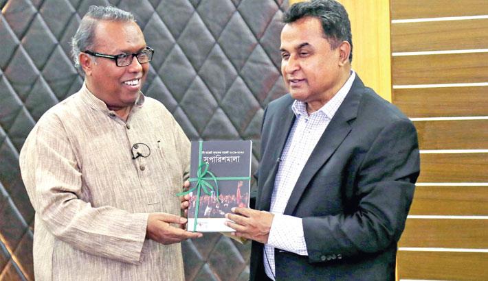 Channel-i Director Shykh Seraj hands over a book