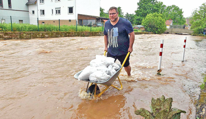 A man transports sandbags in Kaufungen near Kassel