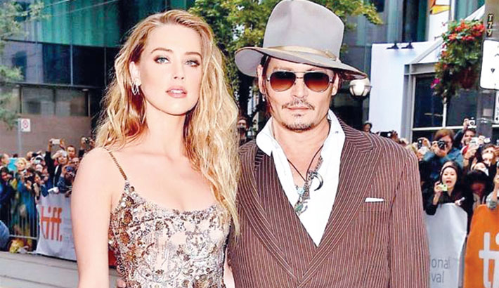 Johnny Depp claims Amber 'painted on bruises'
