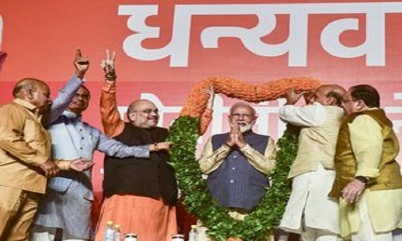 BJP crosses 300 mark, Congress bags 52 as counting nears end
