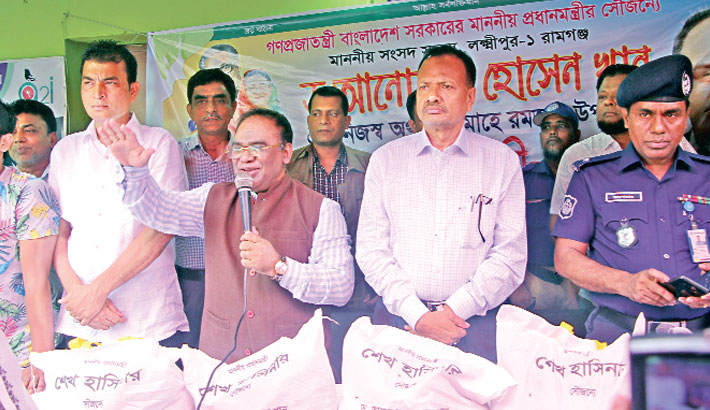 Distribution food items, news clothes among poor people