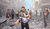 A man evacuates a young bombing casualty