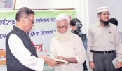Obaidul Quader hands over a gratuity cheque to a retired official of BRTC