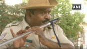 An Indian cop turns his baton to a flute