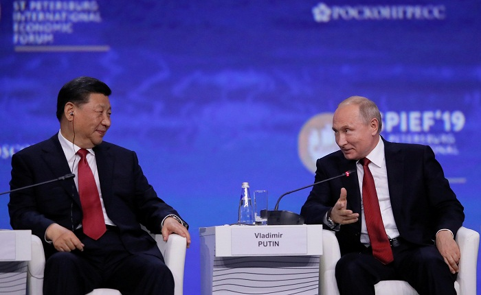 Putin slams attempts to 'push' Huawei from global markets