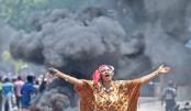 2 die as protesters burn tires, block roads in Haiti