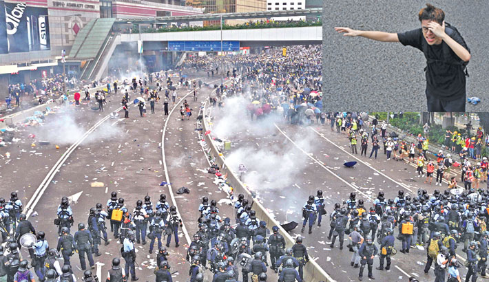 Hong Kong police use tear gas as protesters try to storm parliament