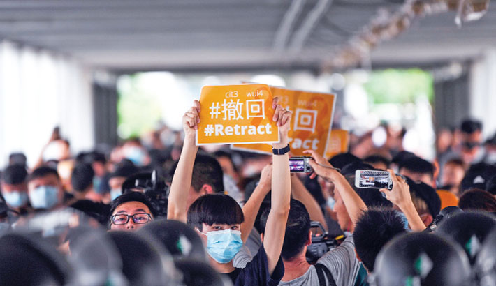 Protesters scuffle with Hong Kong police; govt offices shut