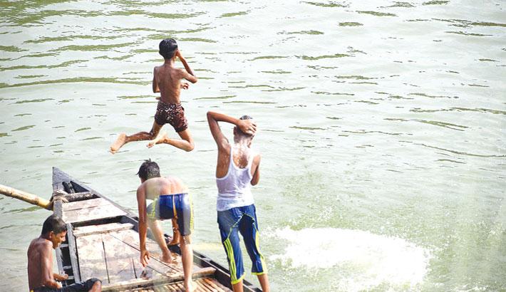 Some boys are taking fun bath in the Padma river