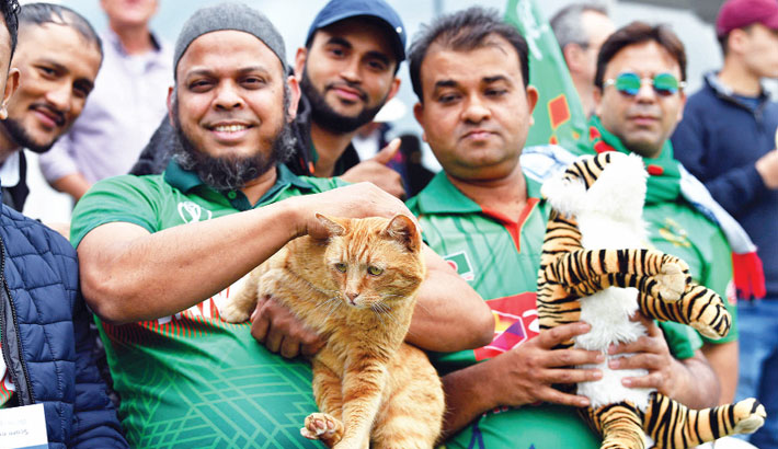 Bangladesh fan in the crowd is seen with a cat