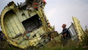 Four charged with shooting down MH17 plane over Ukraine