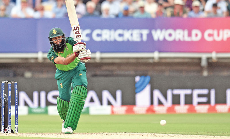 South Africa batsman Hashim Amla, right, plays a shot during their