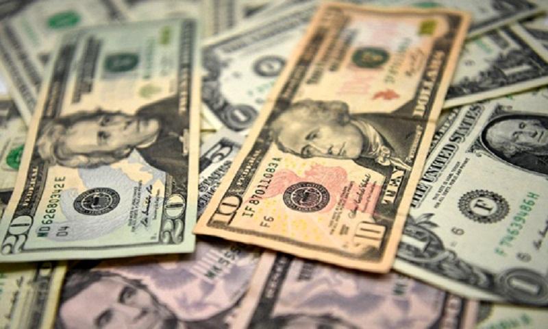 Dollar extends losses, Asia markets rally after Fed's dovish tilt