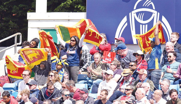 Sri Lanka fans celebrate the half-century of Sri Lanka's Angelo Mathews