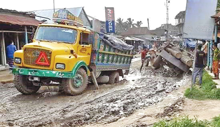 Vehicles are struggling to go through a muddy road