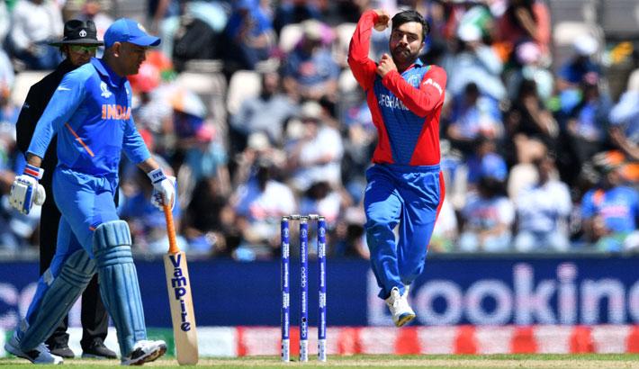 Afghanistan leg-spinner Rashid Khan, right, bowls