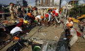 Building under construction topples in Cambodia, killing 17