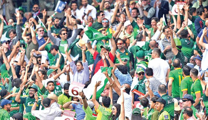Spectators cheer after Pakistan batsman Haris Sohail hit a six