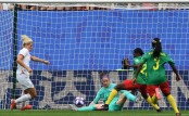 England beat seething Cameroon 3-0 to advance in World Cup