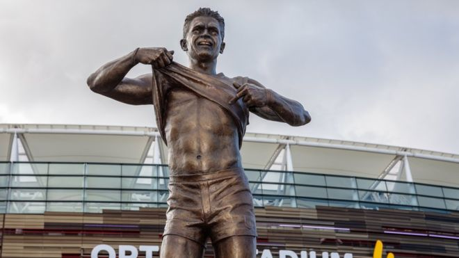 Statue of footballer's stand against racism unveiled in Perth