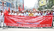 Members of Bangladesh Trade Union Centre take out a procession