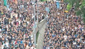 HK protesters march on station to 'educate' Chinese ainlanders