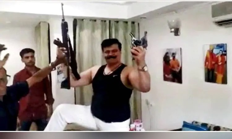 Suspended BJP MLA dances with automatic rifle, guns (Video)