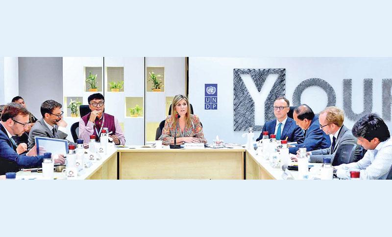 Dutch Queen Máxima speaks with the representatives of development partners