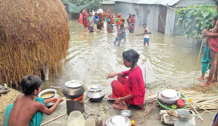 Flood-affected people take shelter on a high land