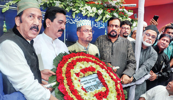 Respects to party Chairman HM Ershad by placing a wreath on his coffin