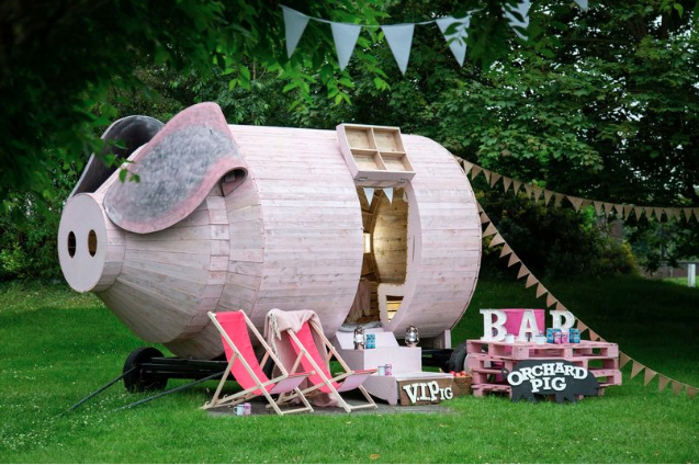 You can now sleep inside a giant wooden pig