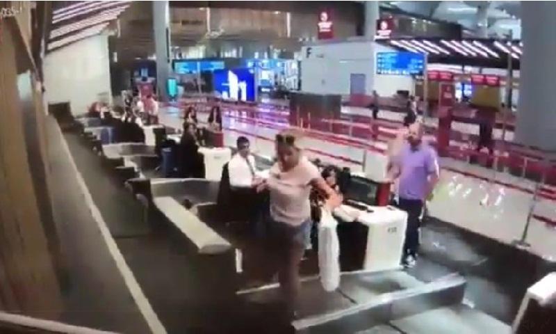 Woman steps onto luggage belt to reach plane