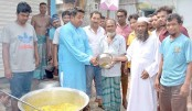 Distributes Khichuri among flood-hit people