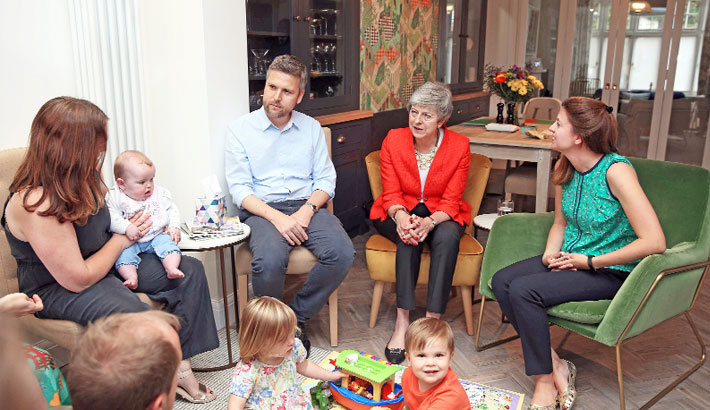 Theresa May meets with new parents and their children in Wimbledon