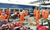 Rescuers evacuate passengers from flooded train in India