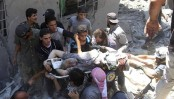 Syrian rebel town pounded, 11 killed in market airstrike