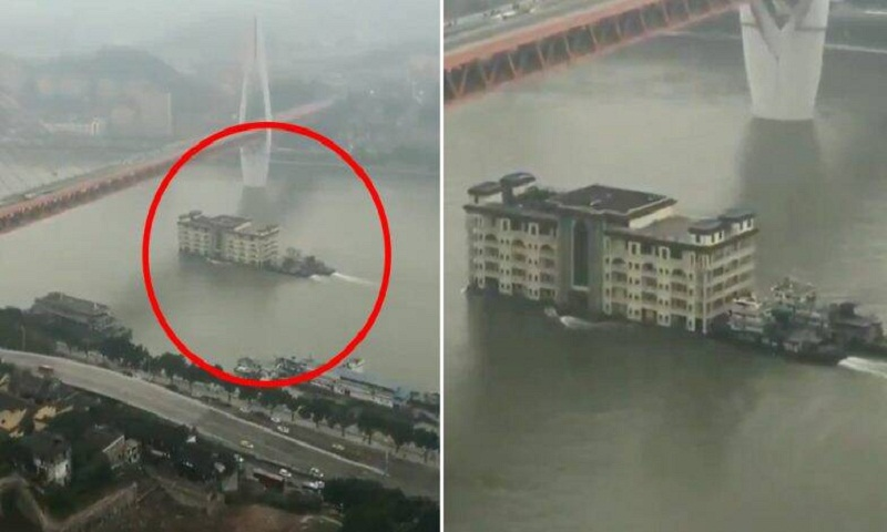 Video of five-storey 'building' floating across China river amuses Twitter
