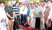 Quader launches  cleanliness  drive in city