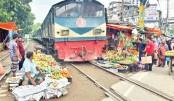 Vendors are selling fruits on railways tracks