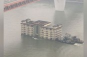 Building floating down a river in China