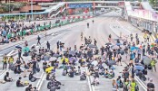 HK protesters seize roads in defiance of China warnings