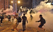 Second night of tear gas as HK protesters defy China warnings