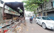 The wreckage of a bus has long been kept on a road at Kazirbagh in the capital's