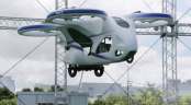 Japan's NEC shows 'flying car' hovering steadily for minute