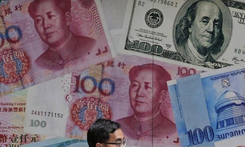 China's yuan falls further to US dollar amid trade war fears