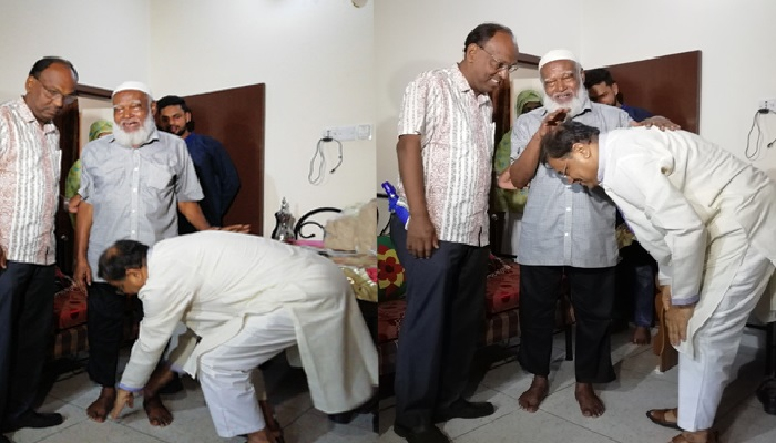Information minister touches school teacher's feet, seeks blessings