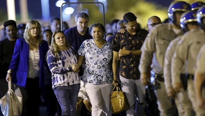 Shootout on freeway overpass leaves officer, gunman dead