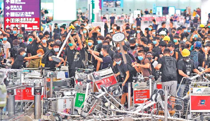 Hong Kong airport protesters retreat