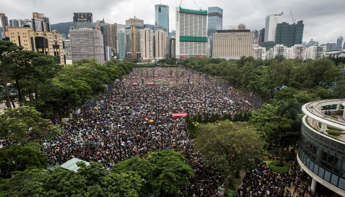 Hong Kong protesters rally to show 'peaceful' credentials after chaos