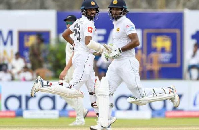 Karunaratne, Thirimanne fifties lead Sri Lanka's victory push